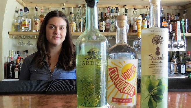 Hannah Haskins, a mixologist at Harvest Bar, created the Ojai Music Festival Notetini cocktail using, from left, Jardesca, California Vodka from Ventura Spirits, and Crescendo limecello. The drink's June 4 launch at Porch Gallery in Ojai will benefit BRAVO, the festival's education and community program.