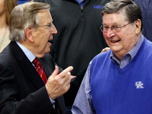 Veteran broadcaster Brent Musburger, left, chats with former Kentucky head coach Joe B. Hall prior to an NCAA college basketball game between Kentucky and Georgia, Tuesday, Jan. 31, 2017, in Lexington, Ky. The game marks Musburger's last broadcast. (AP Photo/James Crisp)