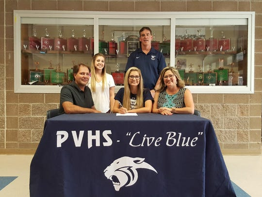 Piedra Vista's Rebekah Eaves, center, signs a letter of intent to play volleyball for Arizona Western College on Wednesday at Piedra Vista High School.