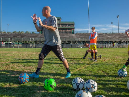 Hugh Brown, founder of the Synergy Football Club, directs a recent training session with his older players at Centennial Field.