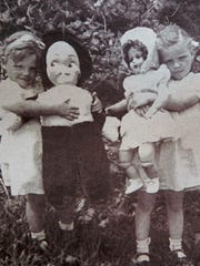 Monica and her Nancy doll are pictured with LaMerle and her 1952 Christmas doll.