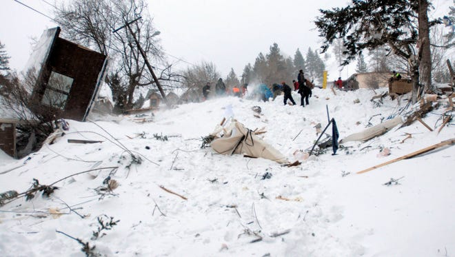 Rescuers dig at the scene of an avalanche in Missoula's Rattlesnake Valley on Friday, Feb. 28, 2014.2