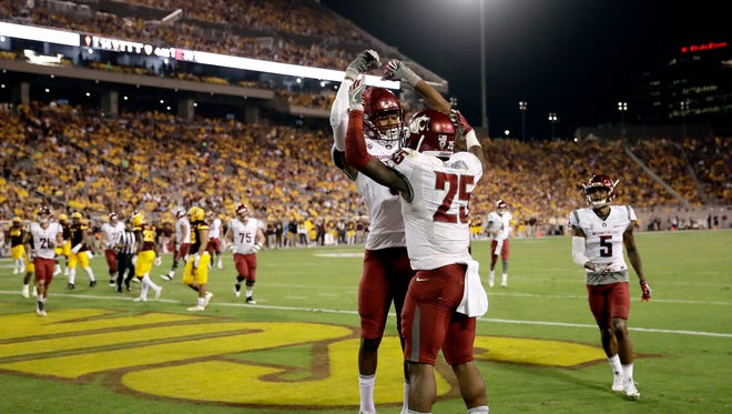 Washington State running back Jamal Morrow (25) celebrates his touchdown catch with teammate Isaiah Johnson-Mack during the second half of an NCAA college football game against Arizona State, Saturday, Oct. 22, 2016, in Tempe, Ariz.