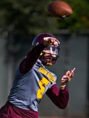 Manny Wilkins throws a a pass during an Arizona State