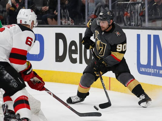 Vegas Golden Knights left wing Tomas Tatar (90) handles the puck in front of New Jersey Devils defenseman Andy Greene (6) during the second period of an NHL hockey game Wednesday, March 14, 2018, in Las Vegas. (AP Photo/John Locher)