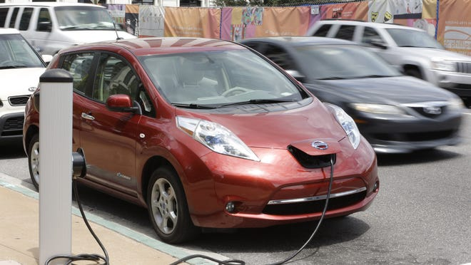Despite falling gas prices, which made hybrids and electric vehicles less attractive, sales of the Nissan Leaf rose 35% through November.
