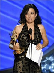 Julia Louis-Dreyfus accepts the award for outstanding