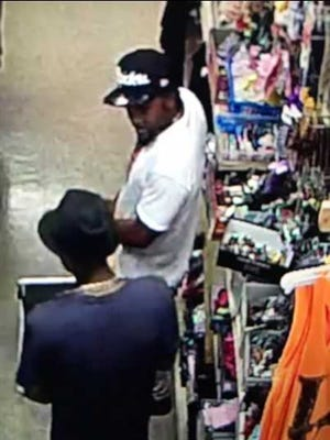 Suspect 2 in alleged robbery of Tmart on Monday, March 26.