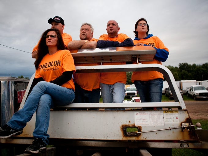 From left, Darlene Fox, Jason Tiffany, Tom Fox, Chris Hilton and Nickie Earl of Canandaigua watch a race from the top of a truck at Canandaigua Motorsports Park on Saturday, August 16, 2014. Fans and racers wore orange in honor of Kevin Ward Jr., who was killed at the racetrack on Aug. 9.
