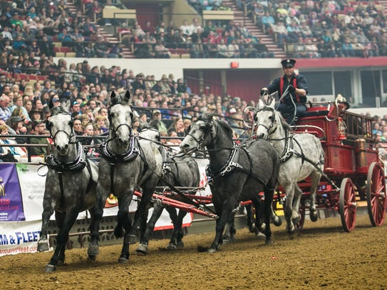 Six-horse hitch Smokin' 6 performs during the Midwest