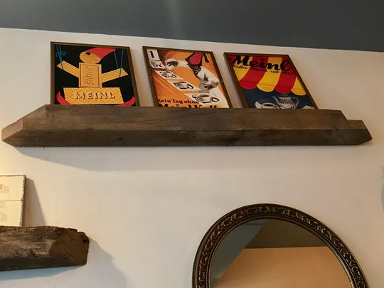 Copies of vintage Julius Meinl Coffee posters stand on a shelf at Red June Cafe, 773 N. Jefferson St.