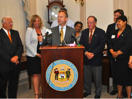 "Gov. Jack Markell in June 2012 signs legislation to rein in predatory practice of short-term ""payday"" loans. Additional reforms are being proposed."