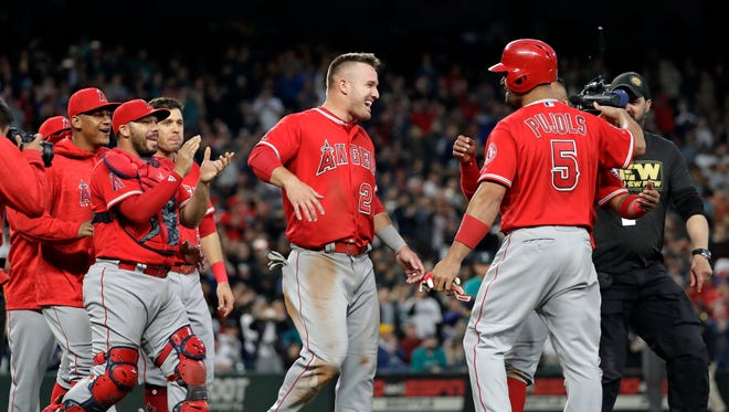 Mike Trout and friends converge to congratulate Angels slugger Albert Pujols on his 3,000th hit.