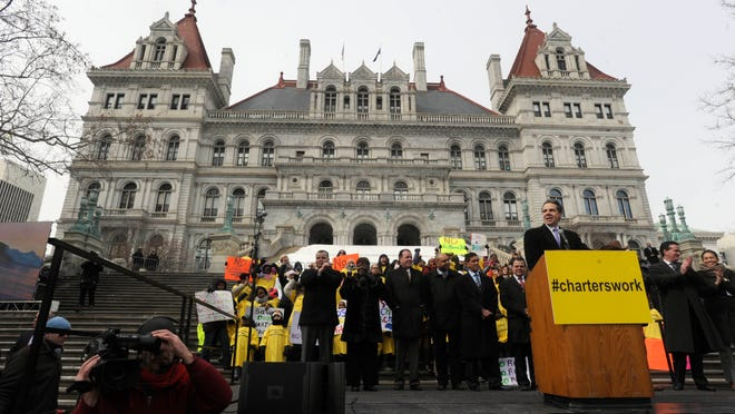 Gov. Andrew Cuomo speaks at a rally in support of charter schools on the steps of the state Capitol in Albany in March. A new report takes issue with state spending on public education, saying New York has reneged on billions of dollars in funding.