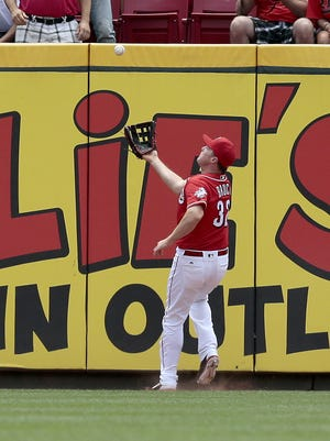Cincinnati Reds right fielder Jay Bruce (32) catches a fly ball at the warning track off the bat of Chicago Cubs third baseman Javier Baez (9) in the top of the first inning of the MLB National League game between the Cincinnati Reds and the Chicago Cubs at Great American Ball Park on Wednesday, June 29, 2016. After one inning, the Cubs led 3-0.