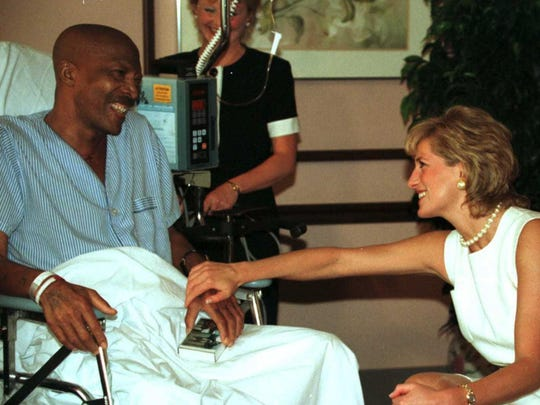 John Collins, left, a 51-year-old lung cancer patient, met Princess Diana as she toured Northwestern Memorial Hospital's Hospice-Palliative Care Unit in Chicago.