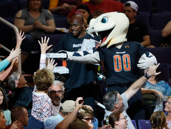 The Rattlers mascot hands out free food to fans during