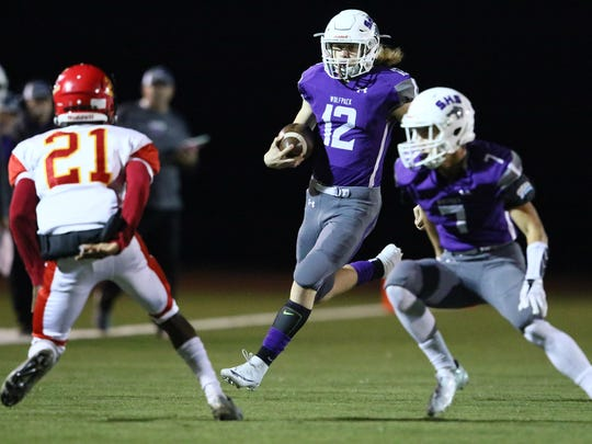 Shasta High's Seth Park (12) looks for an opening in the first quarter against Chico in the section title game Nov. 24 at Thompson Field. Shasta won 62-26 to advance to Saturday's NorCal bowl matchup with Marin Catholic of Kentfield.