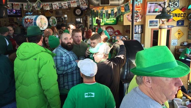 A boisterous crowd fills the second floor of Duggan's Irish Pub in Royal Oak, where a St. Patrick's Day celebration has been underway since 7 a.m. on Monday, March 17, 2014.