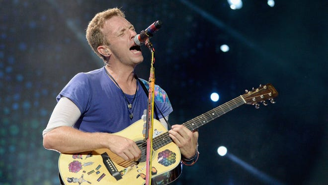 "576812566.jpg EAST RUTHERFORD, NJ - JULY 17:  Recording artist Chris Martin of Coldplay performs onstage during the Coldplay ""A Head Full of Dreams"" Tour at MetLife Stadium on July 17, 2016 in East Rutherford, New Jersey.  (Photo by Kevin Mazur/Getty Images for Atlantic Records)"