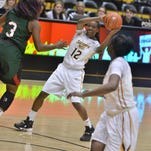 Southern Miss' Brittanny Dinkins looks for an open teammate Friday against Mississippi Valley State.