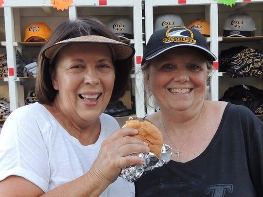 Colt 45s volunteer Terri Stratte enjoys a burger with