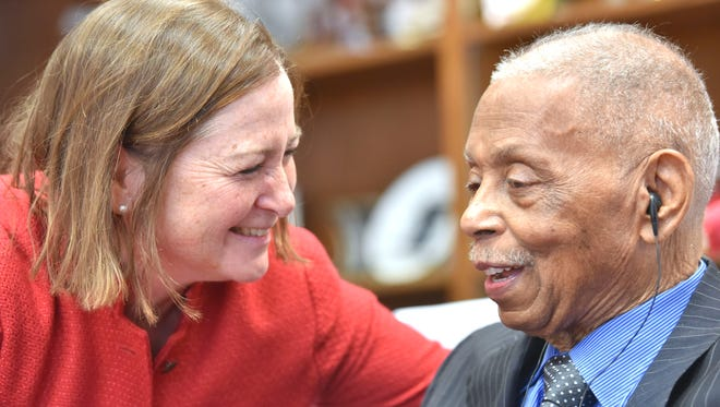 Barbara McQuade, left, former U.S. Attorney in Detroit and current law professor at the University of Michigan, shares a laugh with Judge Damon J. Keith at his  32nd Annual Soul Food Luncheon, February 14, 2019, in his chambers at the Theodore Levin U.S. Courthouse in Detroit.