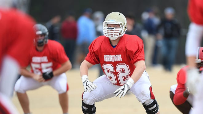 Daniel's Zac McIntosh (62) works on a drill during Shrine Bowl practice at Dorman High Monday.