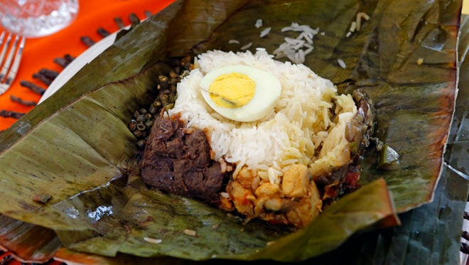 Shereen Thomas' lamprais includes the traditional rice wrapped in a banana leaf, with the addition of chicken, beef rendang (caramelized beef curry), Asian eggplant, Chinese long beans and egg.