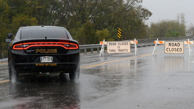 As rain continues on Wednesday, Oct. 28, 2020, a road closed signs are seen on the Arkansas 255 bridge that crosses the Vache Grasse Creek going into Lavaca. As of mid afternoon the road was just beginning to flood in a few areas. The National Weather Service has issued a flood flood warning for Fort Smith that will be in effect until 8 p.m. Wednesday.