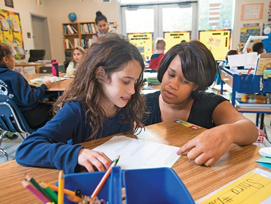 CHIME Institute teacher Megan Holmes helps a fifth-grade