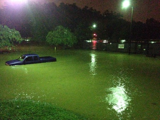 Reader Jason Hughey shared this photo of an abandoned truck under water at Cleveland Park in downtown Greenville after heavy rains and flash flooding Saturday, Aug. 9.  Email your photos to gvnewsmm@gmail.com or upload them at Facebook.com/GreenvilleOnline.