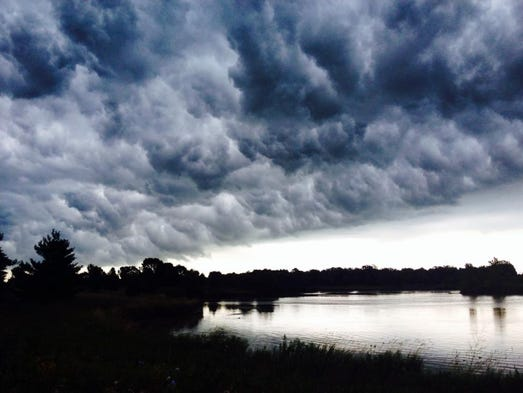 Storm clouds over pond at Camelot Drive just before the rain came pouring down.