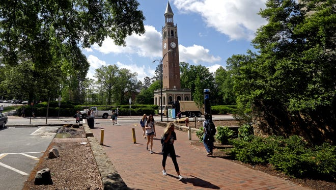 The Bell Tower looms over students on campus at the University of North Carolina in Chapel Hill, N.C.