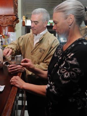 Rep. Brad Wenstrup makes iced coffee at the counter Friday at Schlegel's. Wenstrup came to talk to the community about small business and other topics.