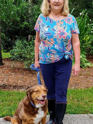 Debbie Inglesby VanBrackle with her dog, Charlie, and the boots she will be wearing when on walks and in the yard.