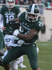 Gerald Holmes breaks a tackle against Penn State on Saturday. The sophomore running back gained 64 yards.