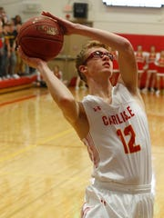 Carlisle junior Nate Norton puts up a shot. Norwalk