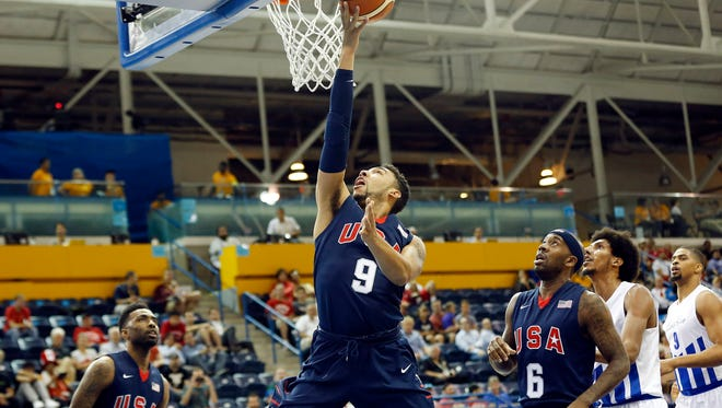 United States forward Denzel Valentine shoots the ball against Puerto Rico in the men's basketball preliminary round during the 2015 Pan Am Games at Ryerson Athletic Centre on Wednesday.