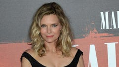 US actress Michelle Pfeiffer poses as she arrives for