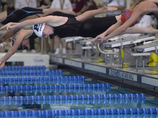 Pittsford's Katie Smith, white cap, takes off from the blocks on her way to winning the 50-yard freestyle final with a time of 22.77.