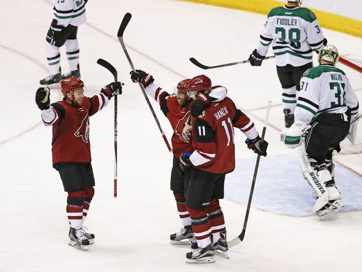 Arizona Coyotes Max Domi (left) celebrates a goal by