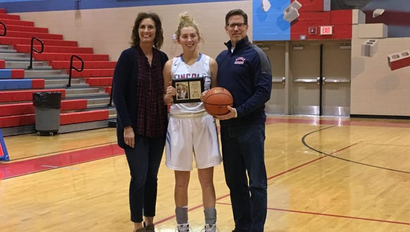 Anna Brecht poses with her parents, Amy Mickelson Brecht