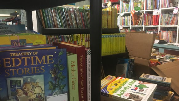 Children's books fill the shelves in one section of