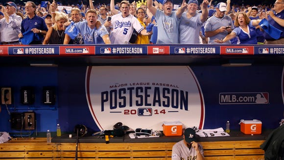 Oakland Athletics relief pitcher Luke Gregerson sits in the dugout after Oakland lost 9-8 in 12 innings to the Kansas City Royals in the AL wild-card playoff baseball game Tuesday, Sept. 30, 2014, in Kansas City, Mo. (AP Photo/Jeff Roberson)