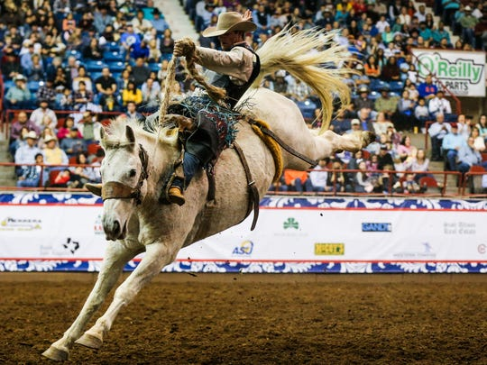 CoBurn Bradshaw rides a bronc during the 8th performance of the San Angelo Stock Show & Rodeo Sunday, Feb. 12, 2017, at Foster Communications Coliseum.