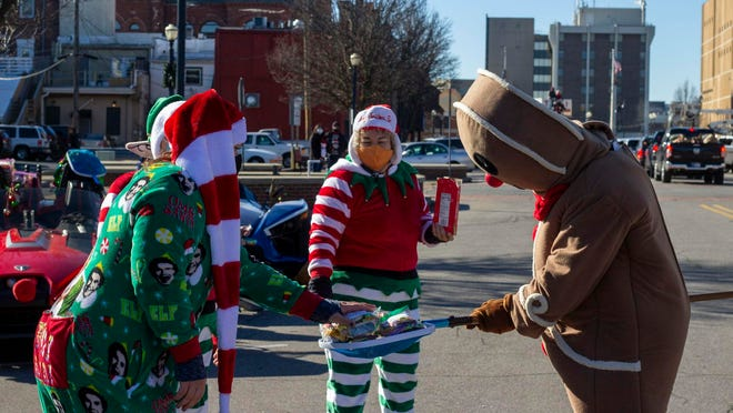 """Hundreds of vehicles visited this year's annual Santa Parade in La Porte, Ind., on Saturday. Organizers turned this year's event into a special """"drive-thru"""" parade due to the COVID-19 pandemic, allowing families to stay in their vehicles and remain socially distanced from others. Dozens of volunteers dressed up for the event, entertaining families that participated."""