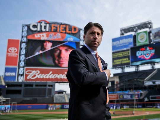 FILE - This April 13, 2015 file photo shows New York Mets chief operating officer Jeff Wilpon standing on the field before the Mets home opener baseball game against the Philadelphia Phillies at Citi Field in New York. Wilpon defended the team's offseason spending, saying more moves are likely before opening day and during the season, Tuesday, Jan. 23, 2018. (AP Photo/Seth Wenig, file)