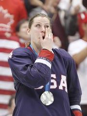 Ruggiero wipes tears during the medal ceremony at the