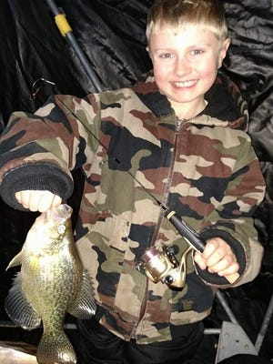 Chayton Carlson, 7, with his first crappie of the 2014 ice season. The fish was happily released.
